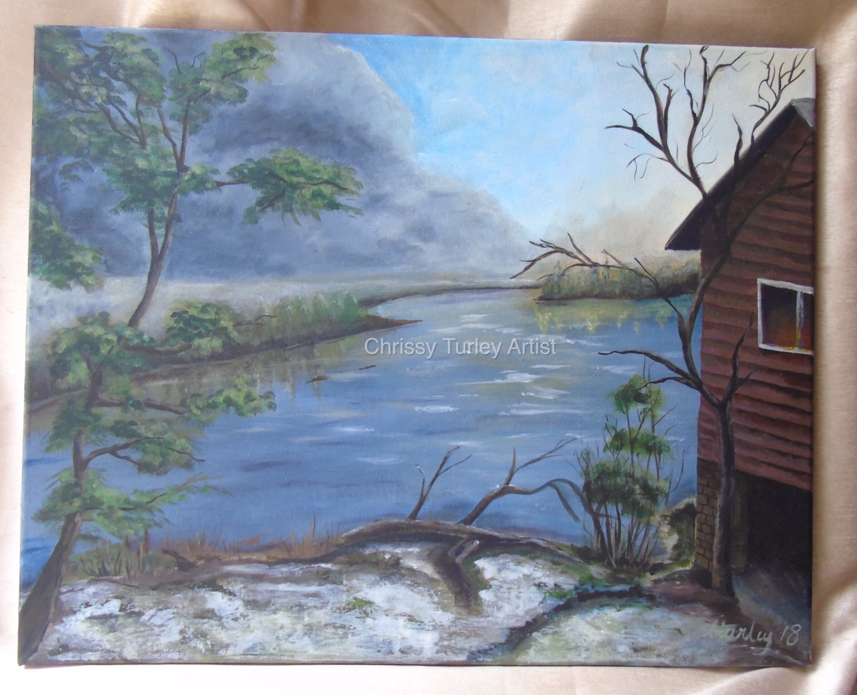 Winter scene of a River and Cabin